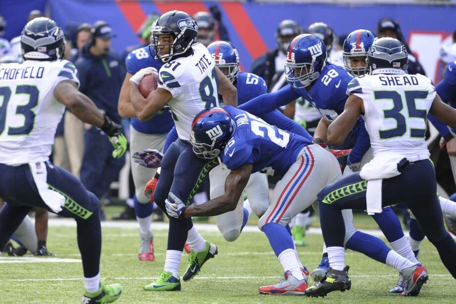 Seattle Seahawks wide receiver Golden Tate (81) is hit by New York Giants free safety Will Hill (25) during the first half of an NFL football game, Sunday, Dec. 15, 2013, in East Rutherford, N.J. (AP Photo/Bill Kostroun) Photo: Bill Kostroun, AP
