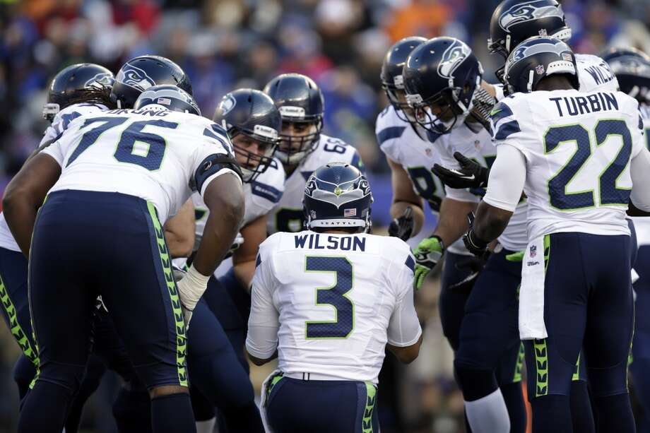 Seattle Seahawks quarterback Russell Wilson (3) huddles with teammates during the first half of an NFL football game against the New York Giants, Sunday, Dec. 15, 2013, in East Rutherford, N.J. (AP Photo/Kathy Willens) Photo: Kathy Willens, AP