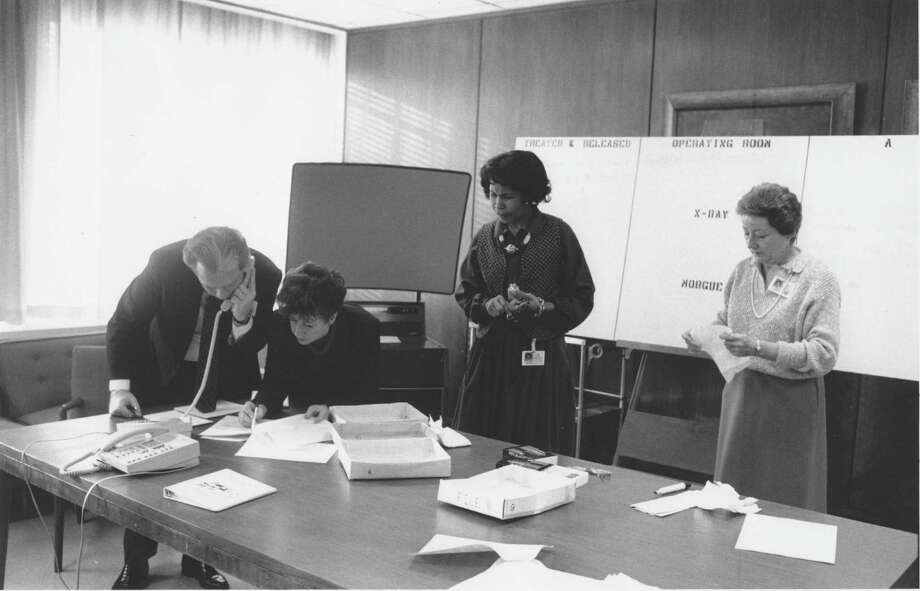 Officials participate in a December 1988 disaster drill at Greenwich Hospital. From left are Frank Corvino, Rene Hobbs, Dolores Perry and Joan Kaiser. Photo: File Photo, Greenwich Time / Greenwich Time