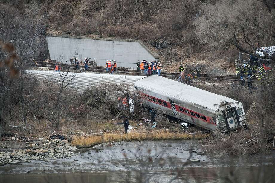 """FILE -- Emergency crews and investigators at the scene after the  derailment of a Metro-North train that left four people dead in the Bronx borough of New York, Dec. 1, 2013. Federal transportation officials said on Dec. 12 that they would begin an extraordinarily rare review of the operations and """"safety culture"""" of the Metro-North Railroad — the first such investigation ever conducted for a passenger railroad. (Robert Stolarik/The New York Times) Photo: Robert Stolarik, New York Times"""