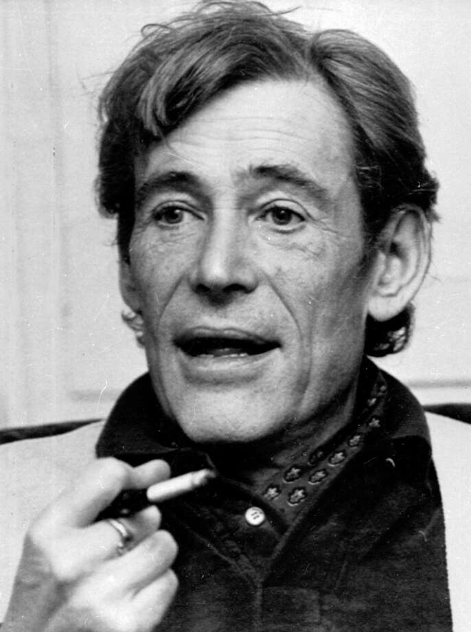 In this Dec. 23, 1980 file photo, actor Peter O'Toole smokes during an interview at his London home. O'Toole, the charismatic actor who achieved instant stardom as Lawrence of Arabia and was nominated eight times for an Academy Award, has died. He was 81. O'Toole's agent Steve Kenis says the actor died Saturday, Dec. 14, 2013 at a hospital following a long illness. Photo: DAVE CAULKIN, AP / A1980