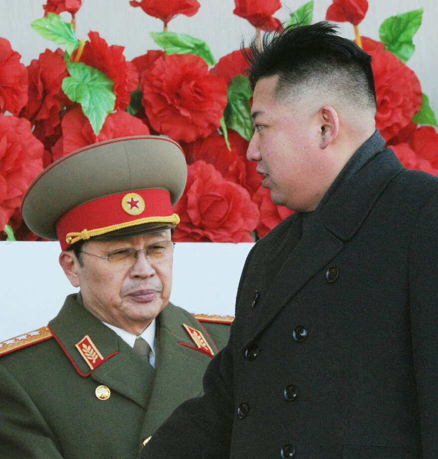 "In this Feb. 16, 2012 file photo, North Korean leader Kim Jong Un walks past his uncle Jang Song Thaek, left, after reviewing a parade of thousands of soldiers and commemorating the 70th birthday of the late Kim Jong Il in Pyongyang, North Korea. North Korean state media say Kim Jong Un's uncle has been executed, calling the leader's former mentor ""worse than a dog."" The announcement on Thursday evening, Dec. 12, 2013,  comes days after Pyongyang announced that Jang Song Thaek had been removed from all his posts because of allegations of corruption, drug use, gambling, womanizing and generally leading a ""dissolute and depraved life."" (AP Photo/Kyodo News, File)  Photo: Uncredited, AP / A2013"