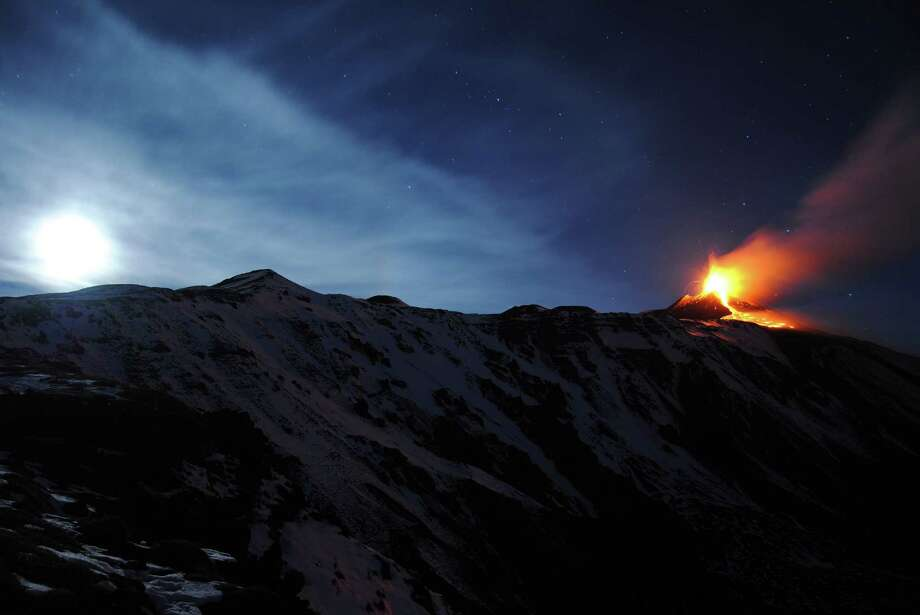 Mt. Etna, Europe's tallest and most active volcano, spews lava during an eruption near the Sicilian town of Catania, Italy, early Sunday, Dec. 15, 2013. Photo: Salvatore Allegra, AP / AP