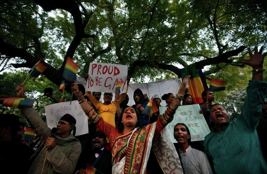 Indian gay rights activists shout slogans during a protest after the country's top court ruled that a colonial-era law criminalizing homosexuality will remain in effect in India in New Delhi, India, Wednesday, Dec. 11, 2013. The Supreme Court threw out a 2009 New Delhi High Court decision that struck down the law as unconstitutional, dealing a blow to gay activists who have argued for years for the chance to live openly in India's deeply conservative society. Lawyers and supporters of gays, lesbians and transsexuals vowed to continue pressing for the removal of the law, which they say encourages discrimination, even if it is rarely invoked by prosecutors. Photo: Altaf Qadri, AP / AP2013