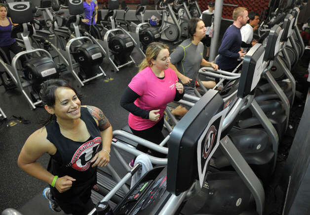 From left Chloe Demetrius, Cerissa Orbegoso, Carlos Miller, Erik Hufnagel and Nahim Isaza run on treadmills during the second annual Marathon on Myrtle treadmill event at Underground Fitness in Stamford, Conn., on Sunday, Dec. 15, 2013. All funds from the charity event go towards Toyota of Stamford's Marathon on Myrtle holiday gift drive which supplies gifts and basic living necessities for clients of Family Centers' who are in the most need. Photo: Jason Rearick / Stamford Advocate