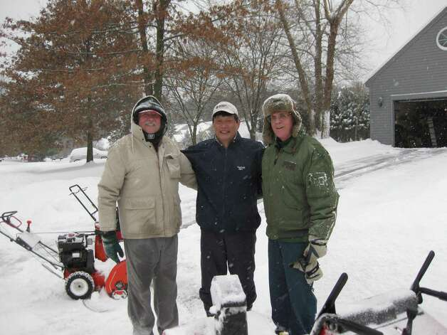 Neighbors on Chesterfield Drive in Voorheesville, from left, Bill Young, Dr. Makoto Hirayama and Jim Reilly, fired up their snow blowers Sunday morning and worked together to dig out the neighborhood.  (Photo submitted by Diane Reilly)