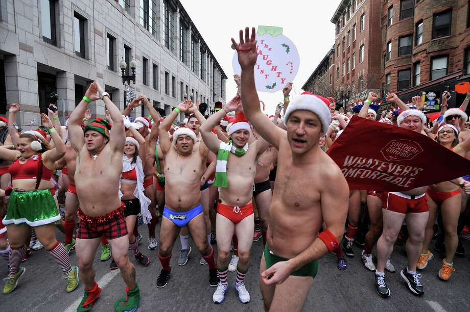 Around seven hundred runners brave the 8 degrees C (17 degrees Fahrenheit) Boston weather to participate in the annual Boston Santa Speedo Run to raise money for the Play Ball Foundation, which supports athletic programs in Boston schools, on December 14, 2013 in Boston, Massachusetts. Photo: Paul Marotta, Getty Images / 2013 Paul Marotta