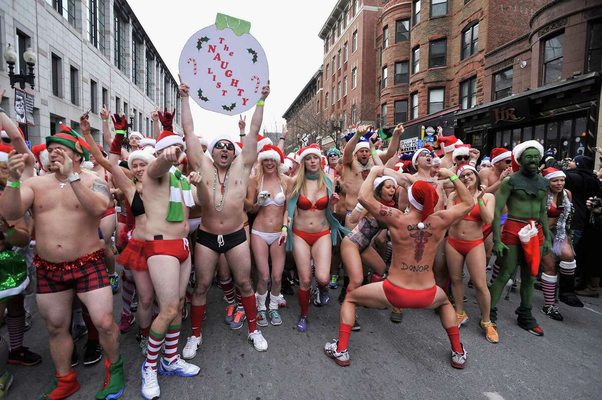 Around seven hundred runners brave the 8 degrees C (17 degrees Fahrenheit) Boston weather to participate in the annual Boston Santa Speedo Run to raise money for the Play Ball Foundation, which supports athletic programs in Boston schools, on December 14, 2013 in Boston, Massachusetts.