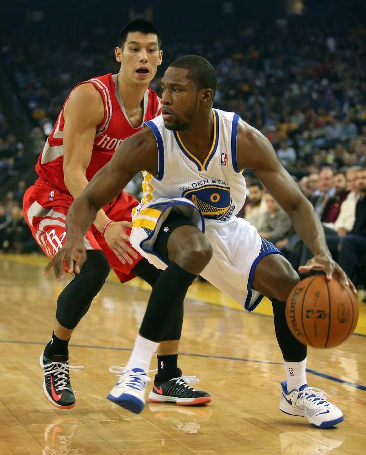 Toney Douglas (0) works against the Jeremy Lin. Photo: JANE TYSKA, McClatchy-Tribune News Service