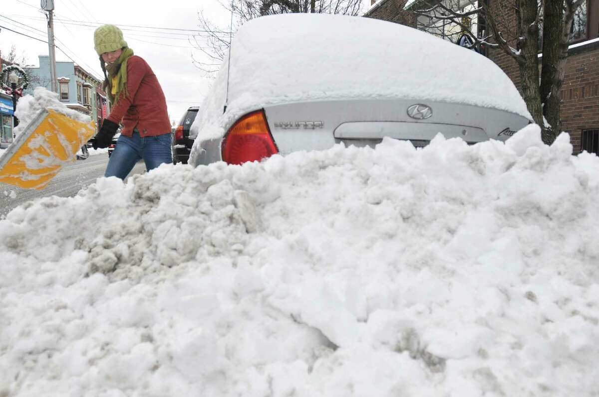 But come December, it got a little more serious . Melanie O'Malley of Albany digs out her car on Lark St. on Sunday, Dec. 15, 2013 in Albany, NY. (Paul Buckowski / Times Union)
