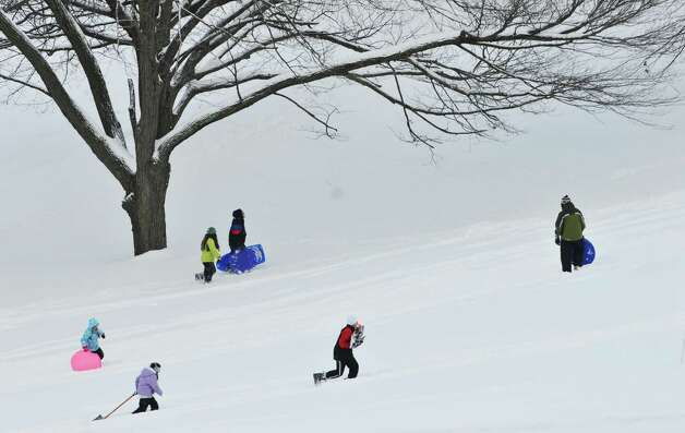 Children make their way back up a hill in Lincoln Park as they went sledding on Sunday, Dec. 15, 2013 in Albany, NY.   (Paul Buckowski / Times Union) Photo: PAUL BUCKOWSKI / 00025049A