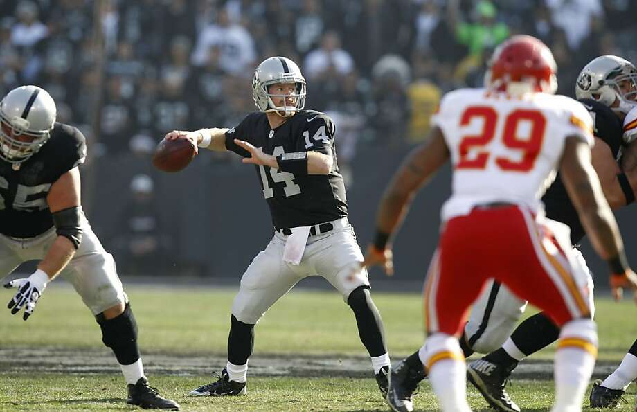 Raiders' quarterback Matt McGloin, (14) back to throw in the first quarter, as the Oakland Raiders take on the Kansas City Chiefs at the O.co Coliseum in Oakland, Ca., on Sunday Dec. 15, 2013. Photo: Michael Macor, The Chronicle