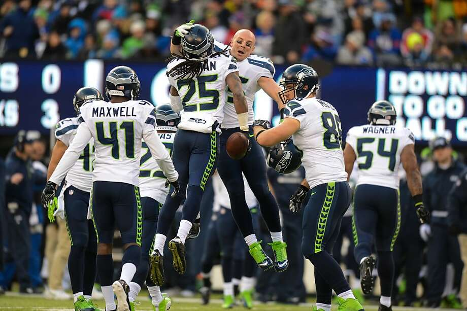 Richard Sherman celebrates after a first-half interception, one of two for him and one of five by Seattle against Eli Manning. Photo: Ron Antonelli, Getty Images
