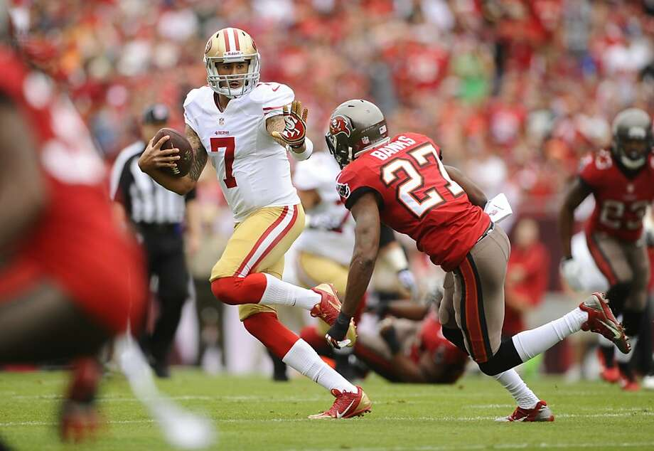 San Francisco 49ers quarterback Colin Kaepernick (7) gets pressure from Tampa Bay Buccaneers cornerback Johnthan Banks (27) during an NFL football game Sunday, Dec. 15, 2013, in Tampa, Fla. Photo: Brian Blanco, Associated Press