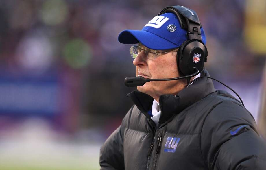 New York Giants head coach Tom Coughlin reacts after Seattle Seahawks wide receiver Doug Baldwin pushed over defenders to score on a touchdown pass from quarterback Russell Wilson during the second half of an NFL football game, Sunday, Dec. 15, 2013, in East Rutherford, N.J. (AP Photo/Peter Morgan) Photo: Peter Morgan, AP