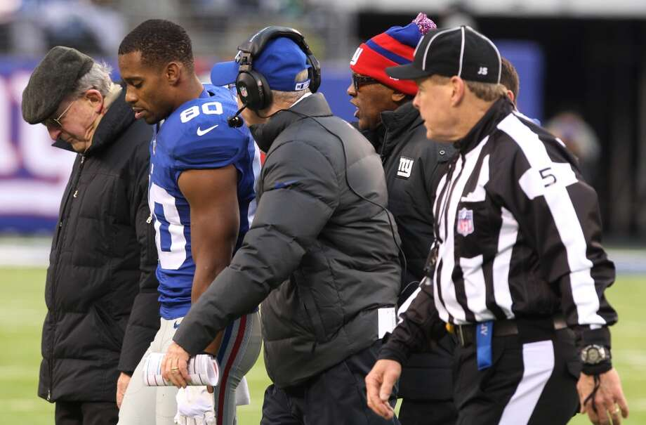New York Giants wide receiver Victor Cruz (80) walks off the field with head coach Tom Coughlin, center left, during the second half of an NFL football game against the Seattle Seahawks, Sunday, Dec. 15, 2013, in East Rutherford, N.J.  (AP Photo/Peter Morgan) Photo: Peter Morgan, ASSOCIATED PRESS