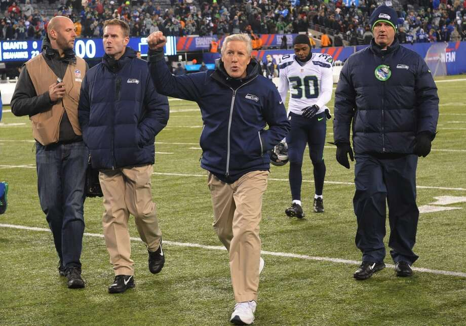 Seattle Seahawks head coach Pete Carroll gestures while leaving the field after an NFL football game against the New York Giants, Sunday, Dec. 15, 2013, in East Rutherford, N.J. The Seahawks won 23-0. (AP Photo/Bill Kostroun) Photo: Bill Kostroun, AP