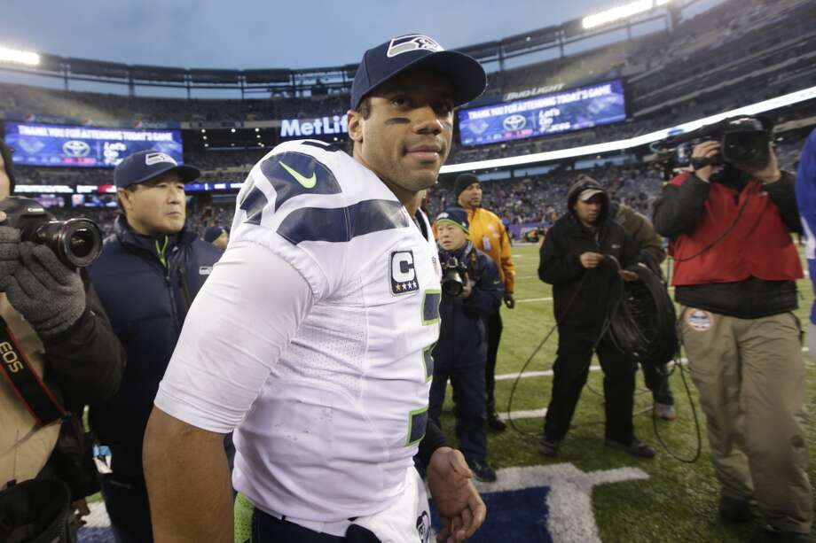 Seattle Seahawks quarterback Russell Wilson walks on the field after an NFL football game against the New York Giants, Sunday, Dec. 15, 2013, in East Rutherford, N.J. The Seahawks won 23-0. (AP Photo/Kathy Willens) Photo: Kathy Willens, AP
