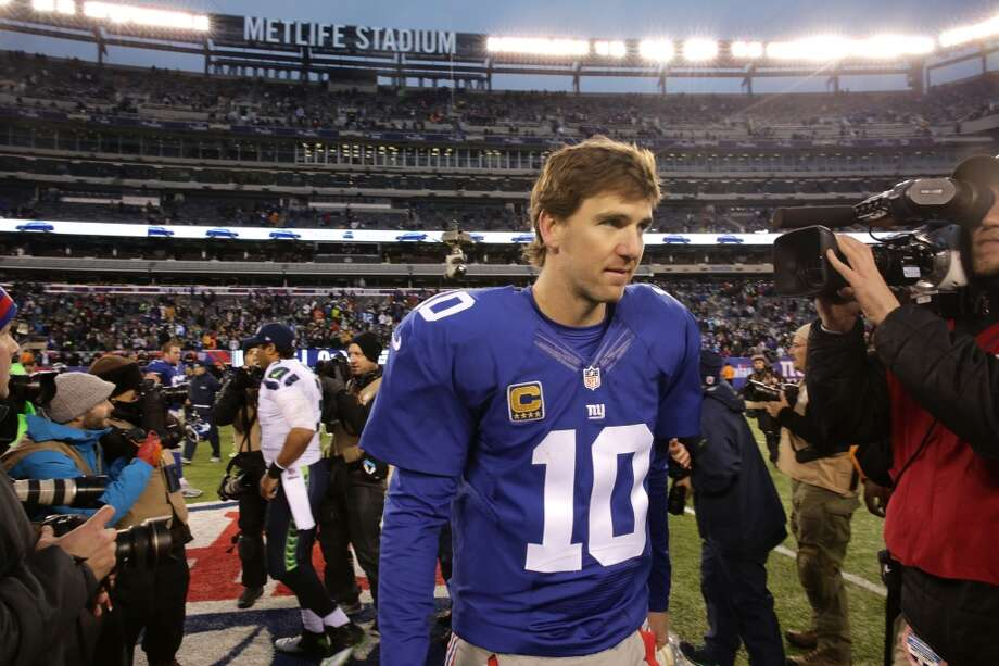 New York Giants quarterback Eli Manning walks on the field after an NFL football game against the Seattle Seahawks, Sunday, Dec. 15, 2013, in East Rutherford, N.J. The Seahawks won 23-0. (AP Photo/Peter Morgan) Photo: Peter Morgan, AP