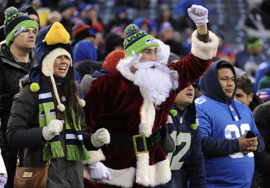 Seattle Seahawks supporters cheer at the end of an NFL football game against the New York Giants, Sunday, Dec. 15, 2013, in East Rutherford, N.J. The Seahawks won 23-0. (AP Photo/Bill Kostroun) Photo: Bill Kostroun, ASSOCIATED PRESS