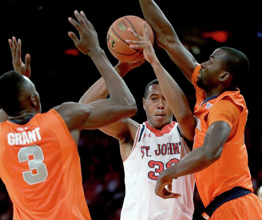 St. John's Orlando Sanchez, center, tries to pass through the arms of Syracuse's Jerami Grant, left, and Baye Moussa Keita during the first half of an NCAA college basketball game, Sunday, Dec. 15, 2013, in New York. (AP Photo/Seth Wenig) ORG XMIT: NYSW104 Photo: Seth Wenig / AP