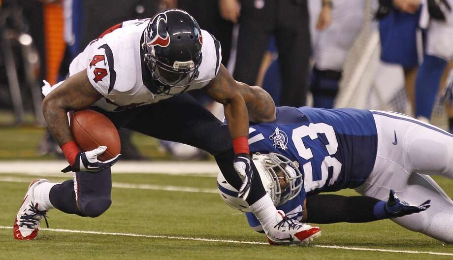 Texans running back Ben Tate is brought down against the Colts. Photo: Brett Coomer, Houston Chronicle