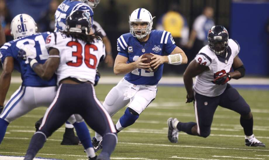 Colts quarterback Andrew Luck scrambles against the Texans. Photo: Brett Coomer, Houston Chronicle