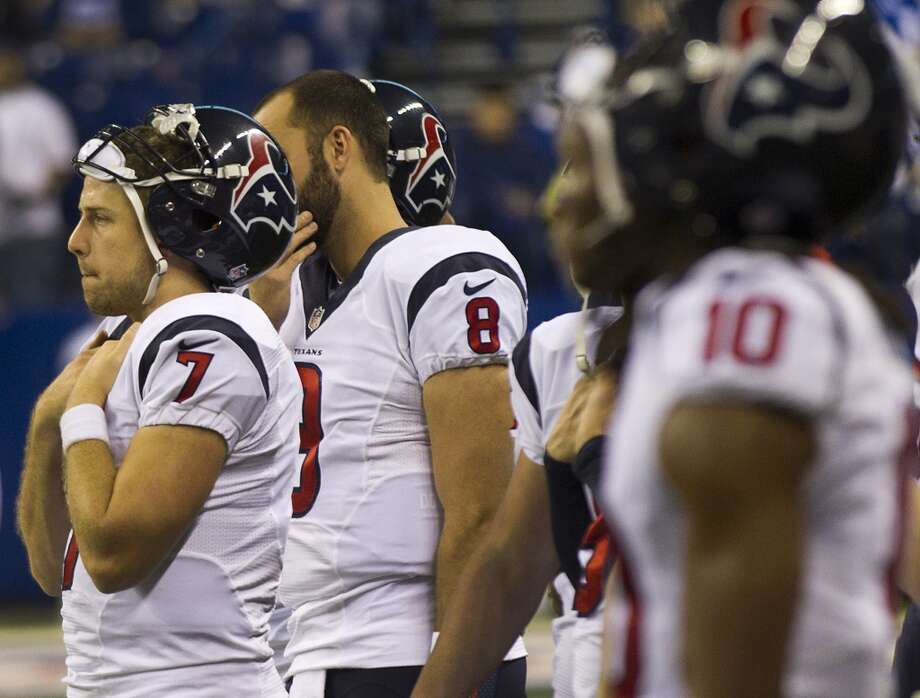 Texans quarterback Case Keenum stands next to Matt Schaub on the sidelines. Photo: Brett Coomer, Houston Chronicle