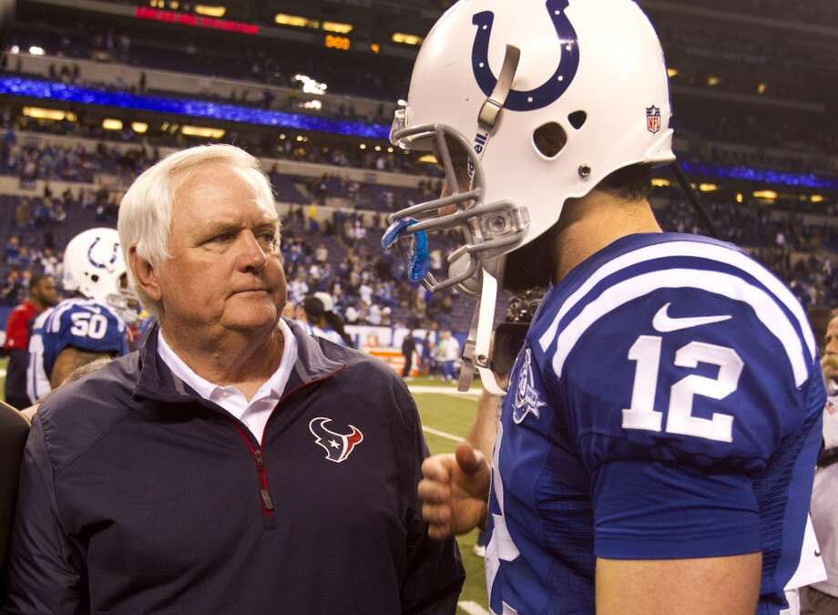Texans interim head coach Wade Phillips speaks with Colts quarterback Andrew Luck. Photo: Brett Coomer, Houston Chronicle