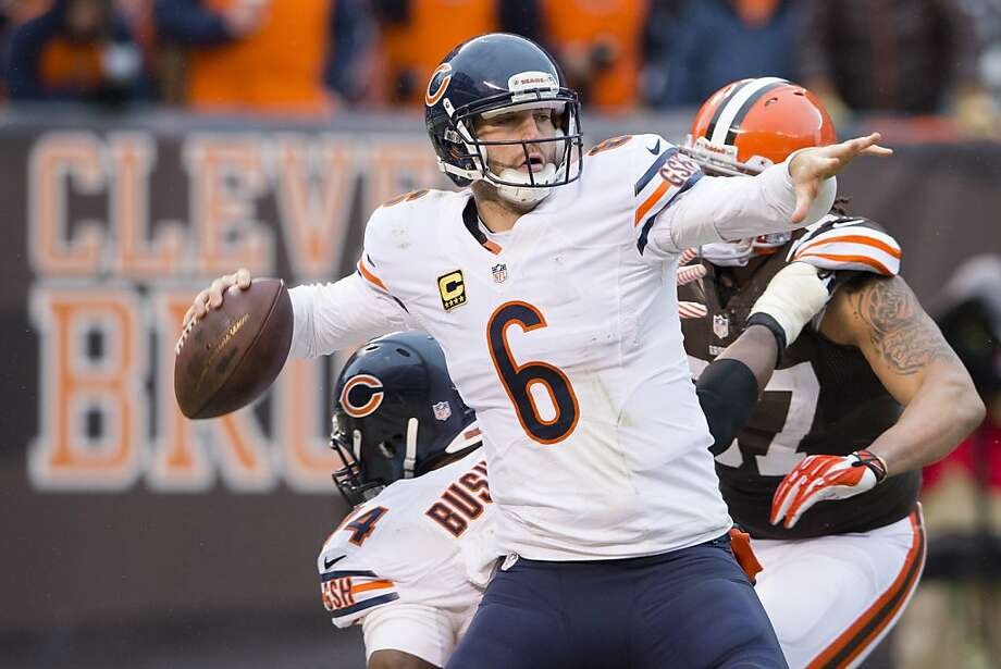 Jay Cutler, who threw three touchdown passes in his return from a four-game absence, leads the Bears from behind in the second half against Cleveland. Photo: Jason Miller, Getty Images