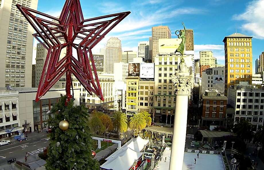 Early-season ice skaters were visible from a perch near the top of the 80-foot-tall Christmas tree last month in Union Square. Photo: Mike Kepka, The Chronicle
