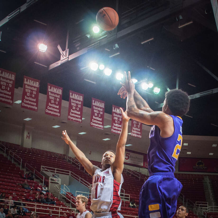 Ty Allen of Tennessee Tech shoots the ball against Keilan Blanks of Lamar University Sunday at the Montagne Center. Photo: Michael Reed / Michael Reed