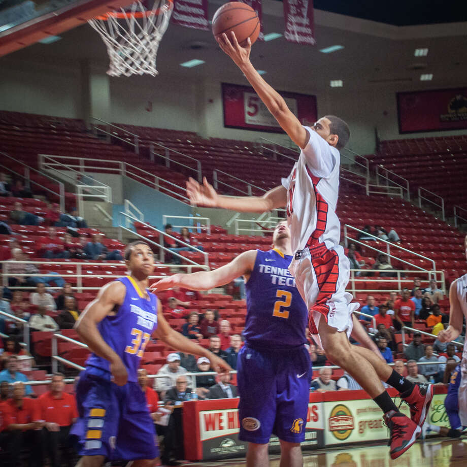 Nimrod Hilliard of Lamar Univeristy works offense  against Tennessee Tech Sunday night at the Montagne Center. Photo: Michael Reed / Michael Reed