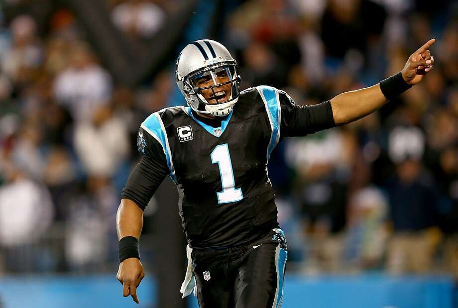 Quarterback Cam Newton threw for 273 yards and a touchdown as his Carolina Panthers pulled into a tie for first place in the NFC South. Photo: Streeter Lecka, Getty Images