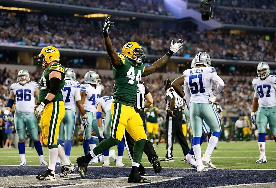 James Starks celebrates his fourth-quarter TD, which helped Green Bay overtake Dallas. Photo: Ronald Martinez, Getty Images