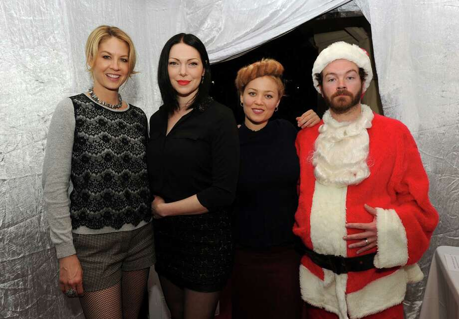 "LOS ANGELES, CA - DECEMBER 14:  (L-R) Jenna Elfman, Laura Prepon, Erika Christensen and Danny Masterson attend the Church of Scientology Celebrity Centre's 21st ""Christmas Stories"" at the Church of Scientology Celebrity Centre on December 14, 2013 in Los Angeles, California. ""Christmas Stories"" benefits the Hollywood Police Department's Youth Development Programs for underprivileged children. Photo: Kevin Winter, Getty Images / 2013 Getty Images"