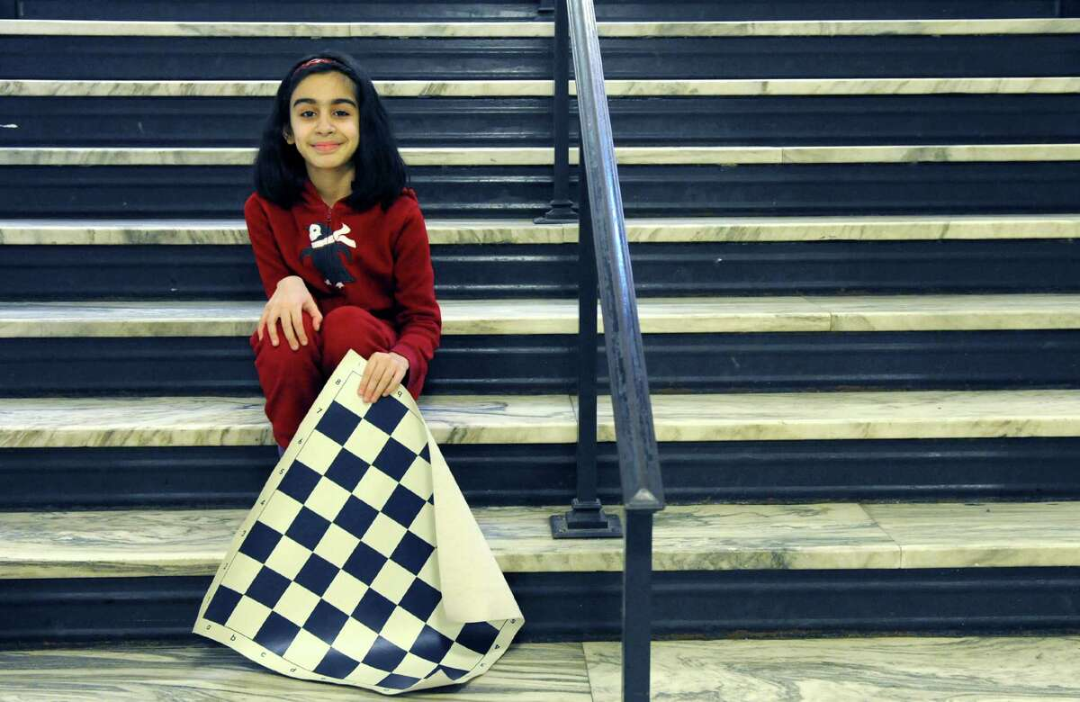 Nine-year-old Martha Samadashvili is pictured Thursday Dec. 5, 2013 in Albany, N.Y. Samadashvili will represent the US in the Upcoming World Youth Chess Championships Dec. 17-29 in the United Arab Emirates. (Michael P. Farrell/Times Union)