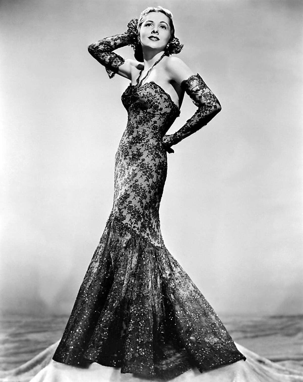File- This April 1945 file photo shows actress Joan Fontaine wearing a gown. The Oscar-winning actress has died at the age of 96. Longtime friend Noel Beutel says she died in her sleep in her Carmel home Sunday, Dec. 15, 2013. (AP Photo/File)