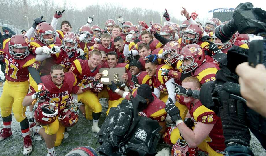 St. Joes' won the state title in convincing fashion, beating Brookfield 54-14. In three state playoffs, the Cadets high-powered offense scored 200 points Photo: H John Voorhees III / The News-Times Freelance