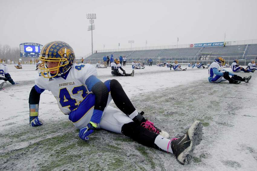 With frigid temperatures and a snow-covered field, the conditions were less than ideal for running and throwing the ball