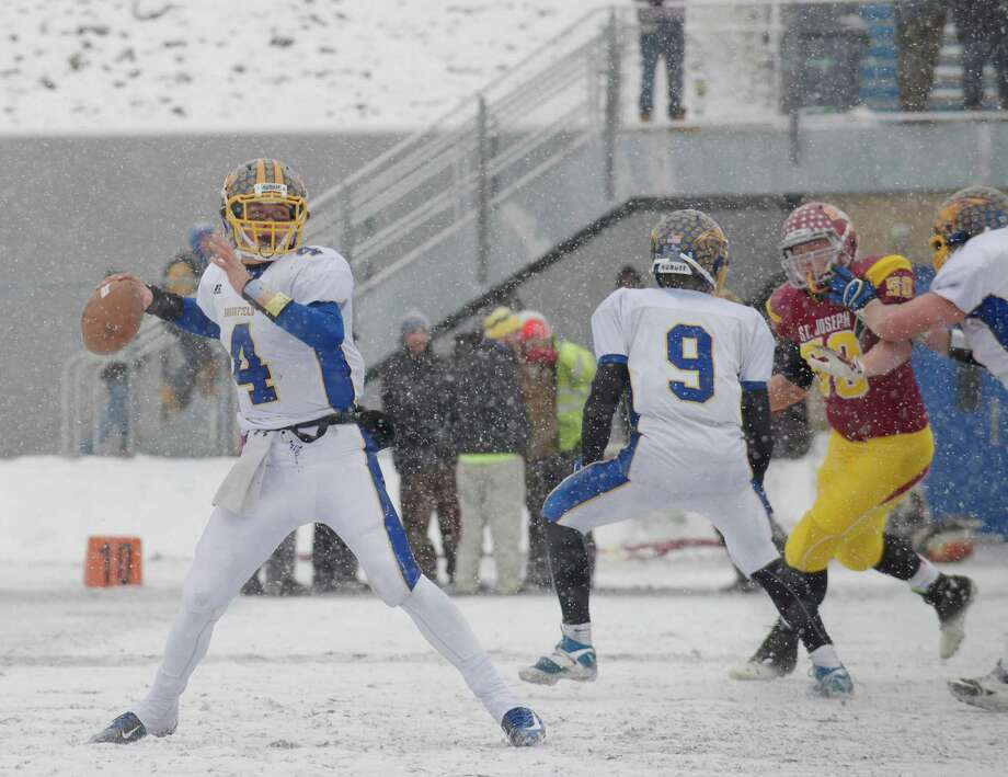 Brookfield's Brad Westmark (4) looks to pass during the Class M football championship game between Brookfield and St Joseph high schools at Central Connecticut State University's Arute Field in New Britain, Conn, on Saturday, December 14, 2013. St Joseph's beat Brookfield, 54-14. Photo: H John Voorhees III / The News-Times Freelance