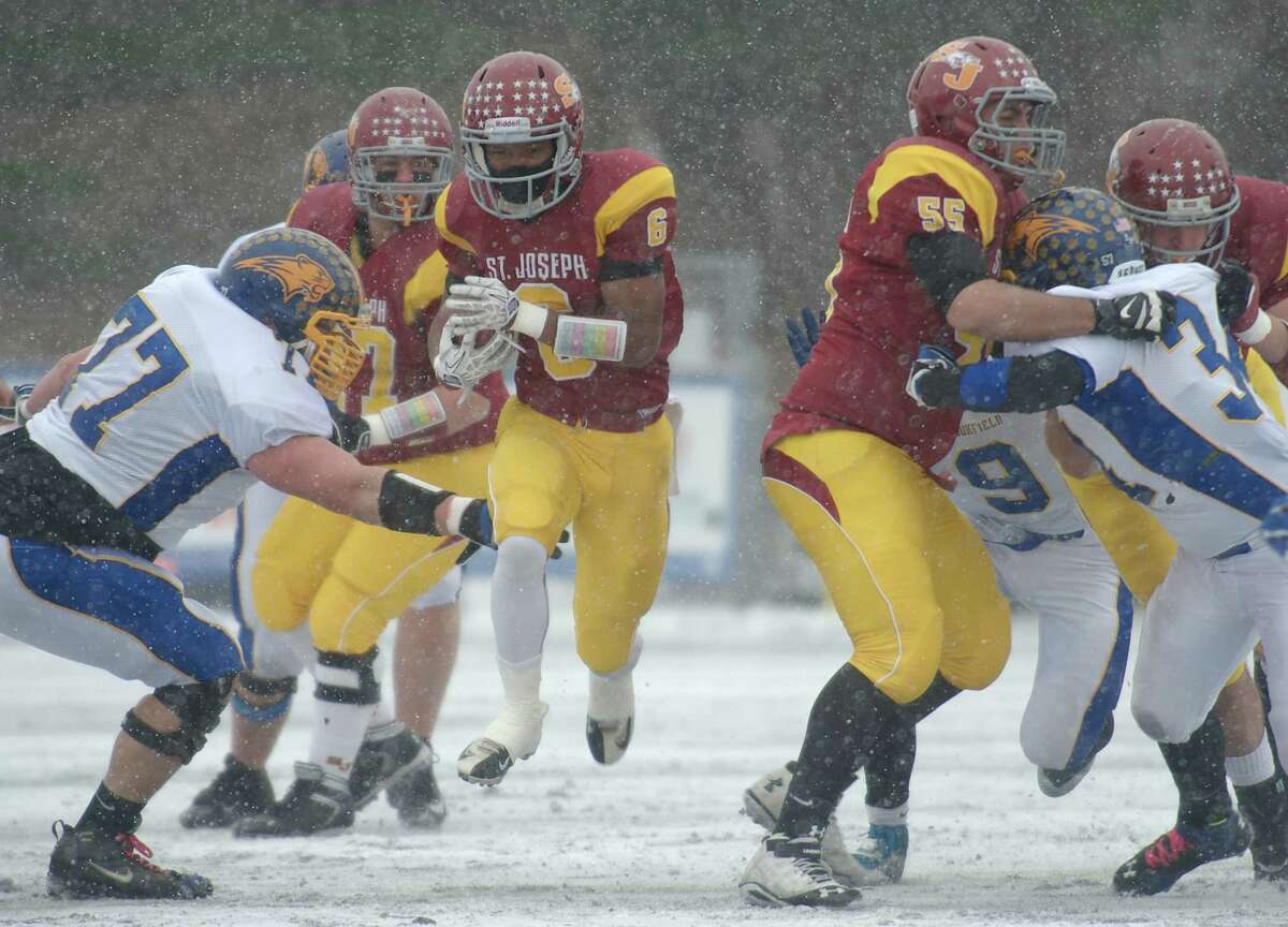 Mufasha Abdul Basir (6) was the MVP for St. Joe's during their run to the Class M title. In the opening-round game against Ledyard, Basir rushed for 324 yards and five touchdowns. After suffering a concussion against Joel Barlow in the semifinals, Basir returned to grind out 166 yards in St. Joe's 54-14 win over Brookfield in the championship game.