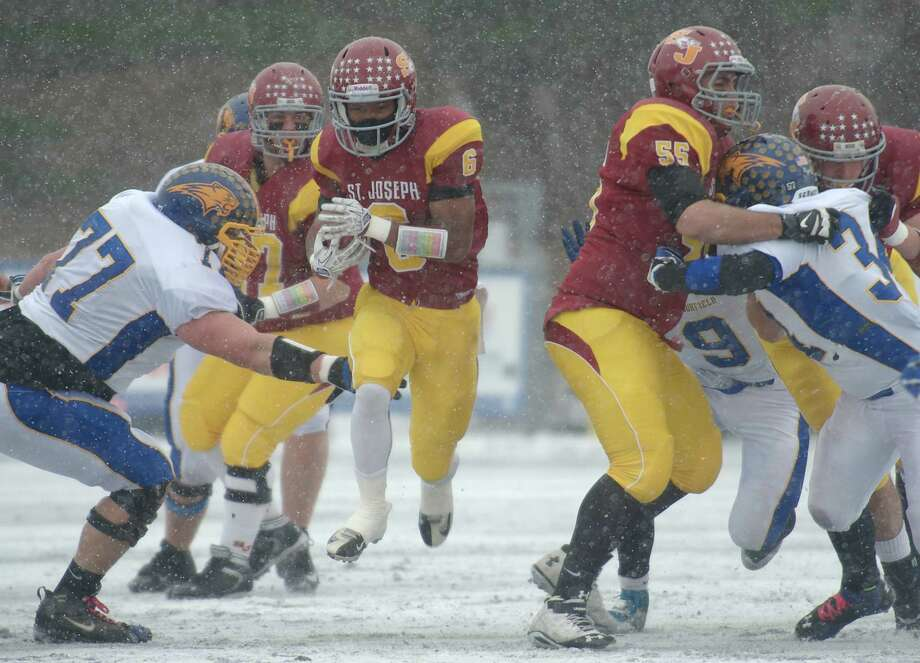 Mufasha Abdul Basir (6) was the MVP for St. Joe's during their run to the Class M title. In the opening-round game against Ledyard, Basir rushed for 324 yards and five touchdowns. After suffering a concussion against Joel Barlow in the semifinals, Basir returned to grind out 166 yards in St. Joe's 54-14 win over Brookfield in the championship game. Photo: H John Voorhees III / The News-Times Freelance