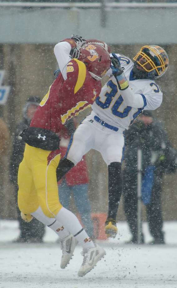 Brookfield's Abdul Hafeez Yussuf (30) tries to knock away a pass to St Joseph's Alex Pinto (18) during the Class M football championship game between Brookfield and St Joseph high schools at Central Connecticut State University's Arute Field in New Britain, Conn, on Saturday, December 14, 2013. St Joseph's beat Brookfield, 54-14. Photo: H John Voorhees III / The News-Times Freelance