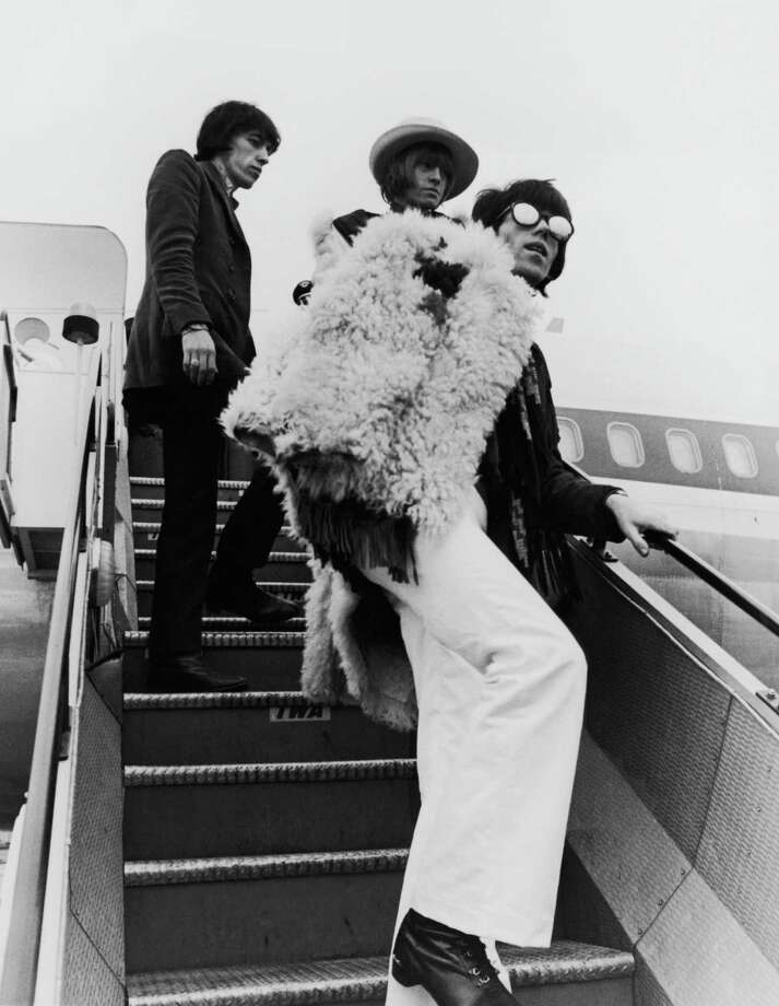 Left to right: Bill Wyman, Brian Jones (1942 - 1969) and Keith Richards board a transatlantic flight from London Airport (now Heathrow), 12th January 1967. Photo: Central Press, Getty Images / 2006 Getty Images