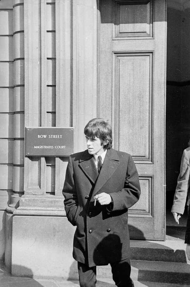 25th March 1965:  Rolling Stones guitarist Keith Richards leaving court after having been fined for driving offences. Photo: Laister, Getty Images / Hulton Archive