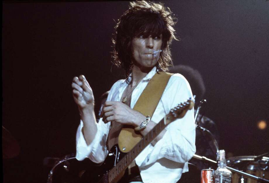 English guitarist Keith Richards of the Rolling Stones on stage during a European tour, 1973. Photo: Michael Putland, Getty Images / 2011 Getty Images