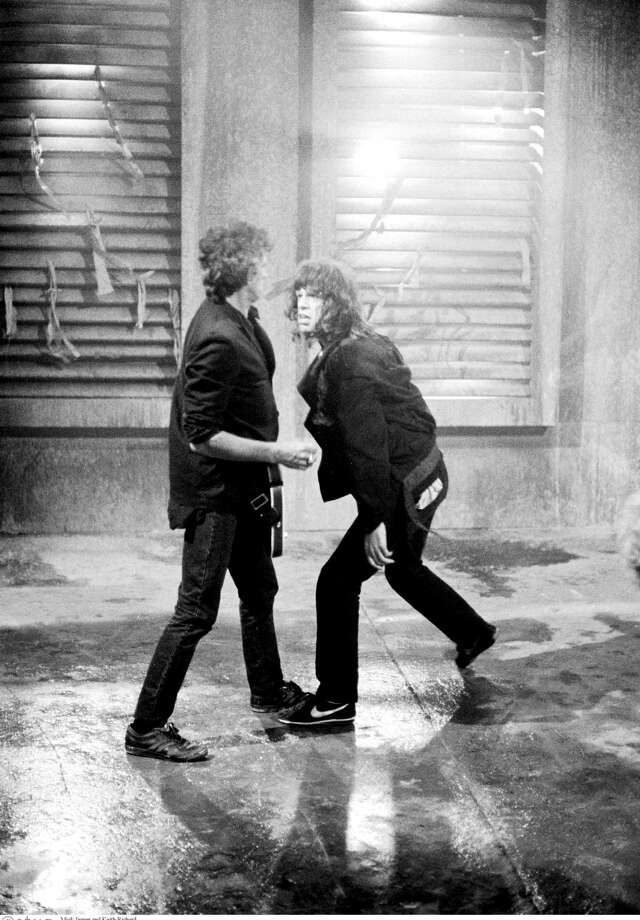 Guitarist Keith Richards and singer Mick Jagger of the Rolling Stones on the set of the music video for 'One Hit (To the Body)' in England in May 1986. Photo: Michael Putland, Getty Images / 2011 Getty Images