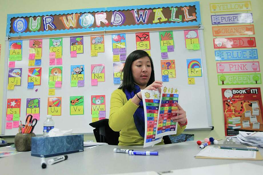 JoAnn Phan prepares for class at DeChaumes Elementary on Friday, Dec. 13, 2013, in Houston. Phan spent a year and a half searching for her first teaching job after graduating from The University of Houston. She's not alone, there were 10,000 fewer first-year teachers in Texas in 2012 than in 2008. ( Mayra Beltran / Houston Chronicle )? Photo: Mayra Beltran, Staff / © 2013 Houston Chronicle