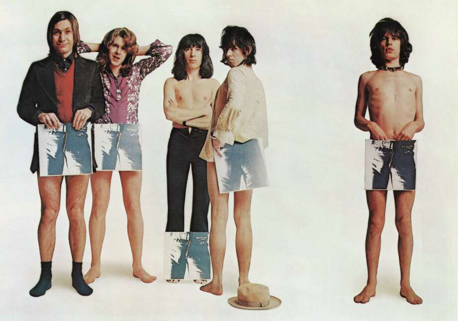 English rock group the Rolling Stones pose, strategically holding copies of their new album 'Sticky Fingers', in a humorous group portrait to promote it's release, 23rd April 1971. The album cover design was conceived by American pop artist Andy Warhol. Left to right: Charlie Watts, Mick Taylor, Bill Wyman, Keith Richards and Mick Jagger. Photo: David Montgomery, Getty Images / 2010 Getty Images